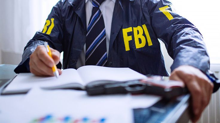 Federal agents were seen removing boxes from a home in Dearborn, Michigan, reportedly while investigating a matter of national security. An FBI spokesperson denied any threat to the public.