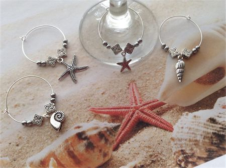 Gorgeous Nautical Beach Wine Glass Charms Sea Shell Starfish Ocean Set x 4 made with metal spacers and beads and Tibetan silver charms. See these and other gift ideas on madeit.com.au