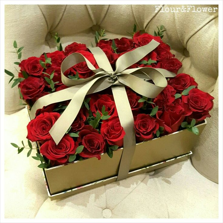 A boxed arrangement of red roses and eucalyptus leaves, created for Valentine's Day by Flour&Flower. Visit our Instagram profile @mylittleflowershop