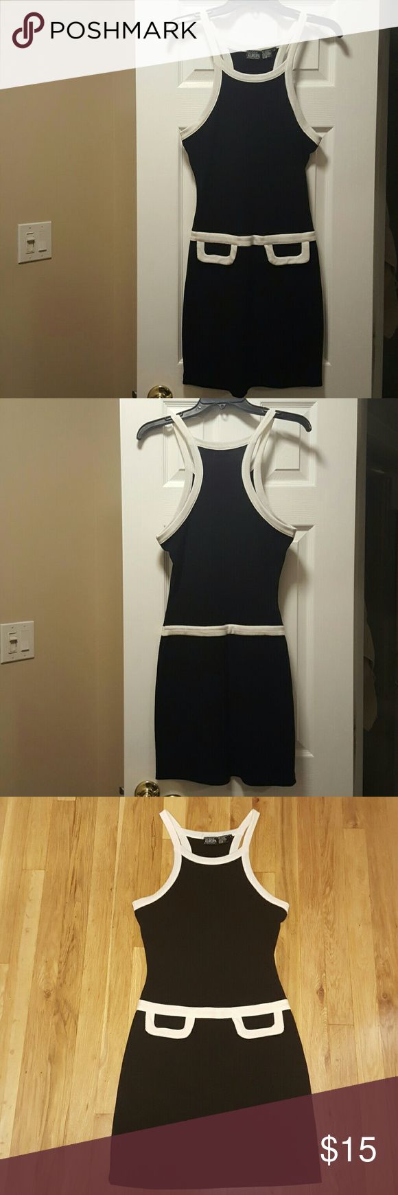 Boutique Europa Dress Black and white boutique Europa by Newport News racer back dress ..polyester cotton spandex makes it so soft and comfortable but very figure flattering boutique Europa  Dresses