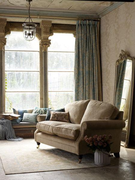 Love the sofa and the mirror against the wall  xo--FleaingFrance