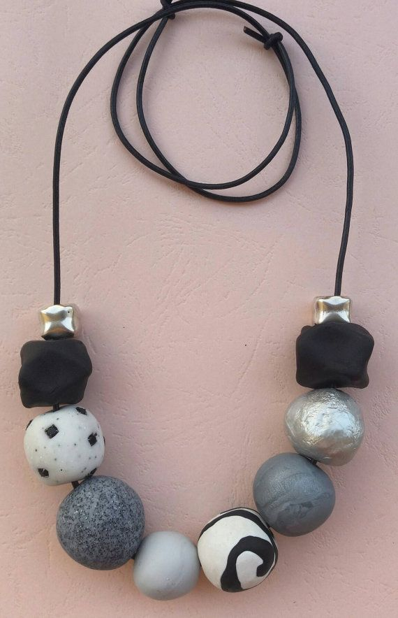 Check out this item in my Etsy shop https://www.etsy.com/listing/386177208/blackwhite-handmade-statement-necklace
