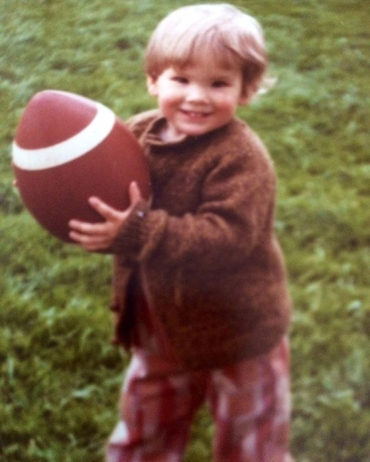 Me at 2 years old. Football would be a totally ridiculous game if the ball were this big -- relative to the player's body. And that uniform... well, it's just fucking terrible.