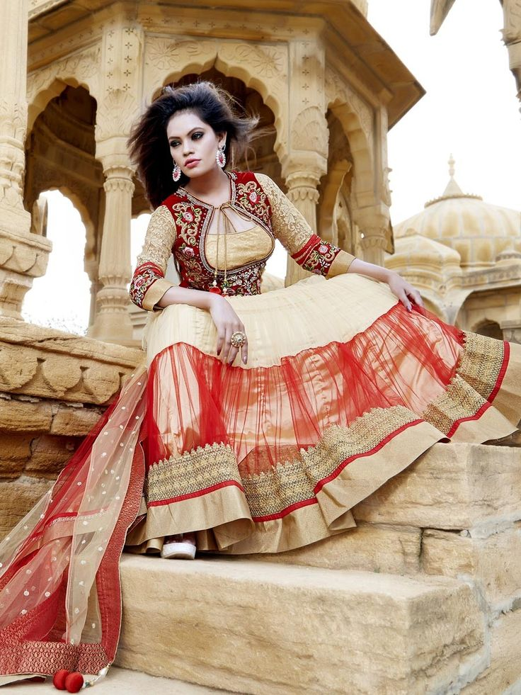 Pleasing beige color net kameez decorated with golden zari, kundan, cutdana work.  Item code: SLKD826 Shop more: http://www.bharatplaza.com/women/readymade-suits.html