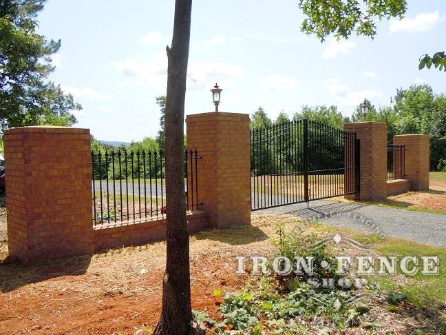 Wrought Iron Fence And An Arched Driveway Gate