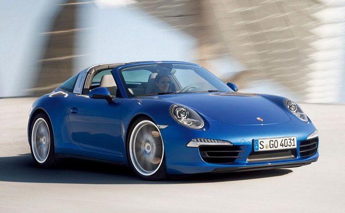 2015 Porsche Targa unveiled, and its debut at the 2014 Detroit Motor Show (NAIAS). The 2015 Porsche 911 Targa features a silver-colored B-pillar and a large and uniquely-shaped wraparound rear window. The roof is electric, and can be opened or closed at the push of a button.