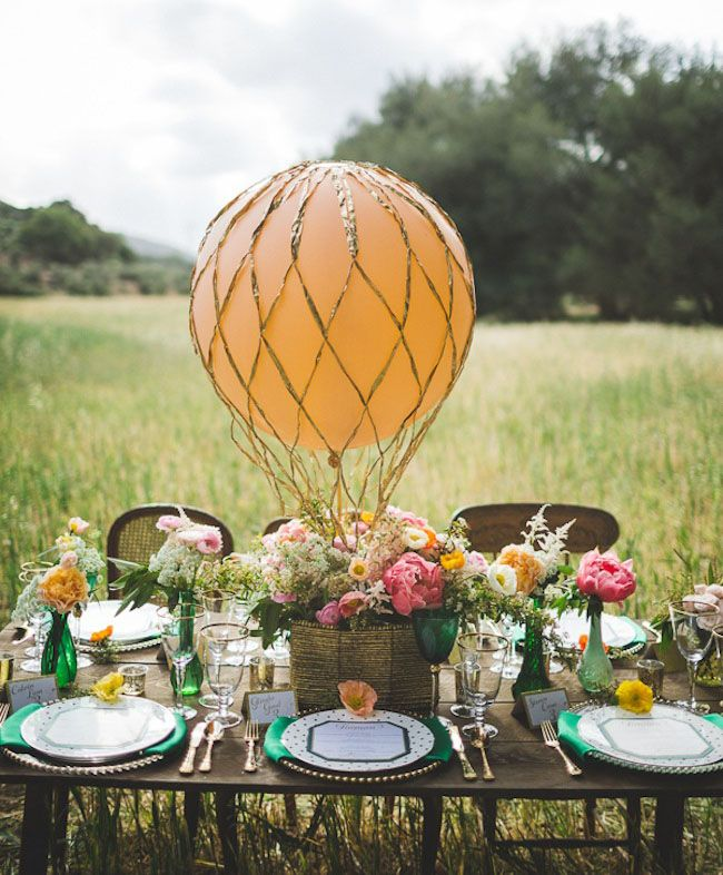 this table setting is whimsical, colourful and just so lovely. the hot air balloon effect is an added element that is relatively easy to accomplish yet creates a whole new dimension to the look.   www.trixandtrumpet.com