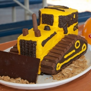 CAT dozer cake... Hum maybe I can make a Bobcat cake...a pink one!
