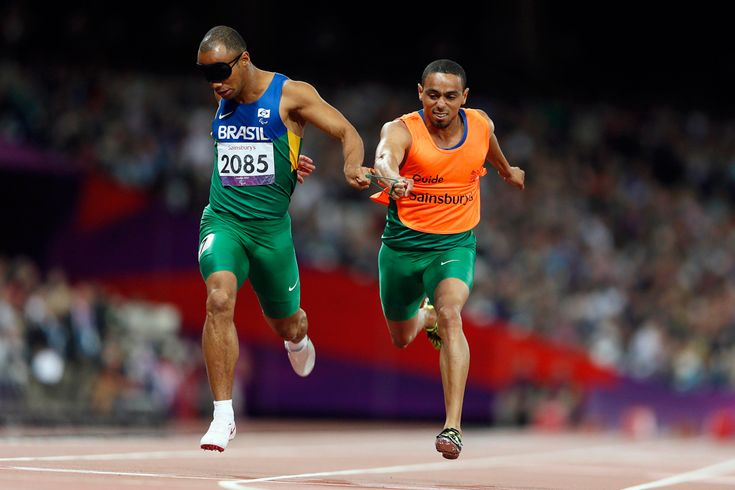 Brasil's Felipe Gomes (left) and his guide Leonardo Souza Lopes run to win the Men's 200-meter final T11 during the London 2012 Paralympic Games at the Olympic Stadium on Sept. 4. (Stefan Wermuth/Reuters)