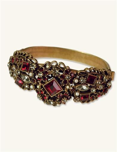 CLARET JEWELS BRACELET  Reminiscent of a glass of red wine held to the light, rubyhued crystals are meticulously hand set within a dramatic collection. Bronze plated brass.