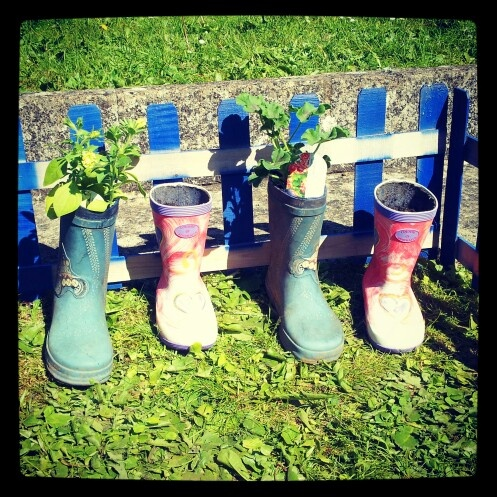 Recycle old wellies, for kids garden :-)