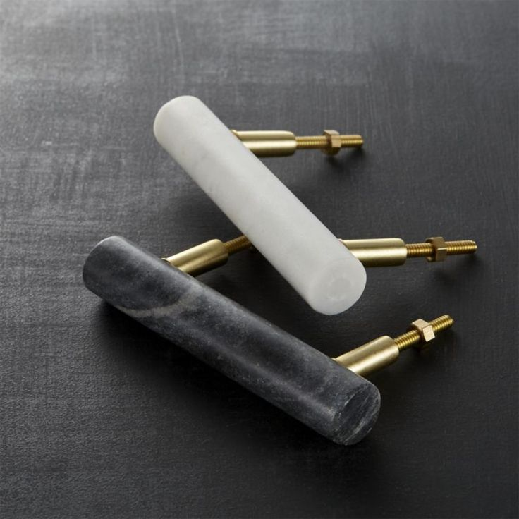 Shop marble handles.   Classic material, modern idea.  Beautiful marble adds a sophisticated finish to doors and drawers.  We especially love them on bathroom vanities/cabinets.