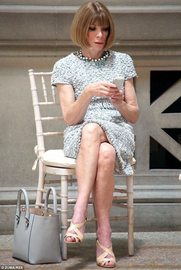 Pictured before the ceremony began, a steely Ms Wintour checked her phone while waiting fo...