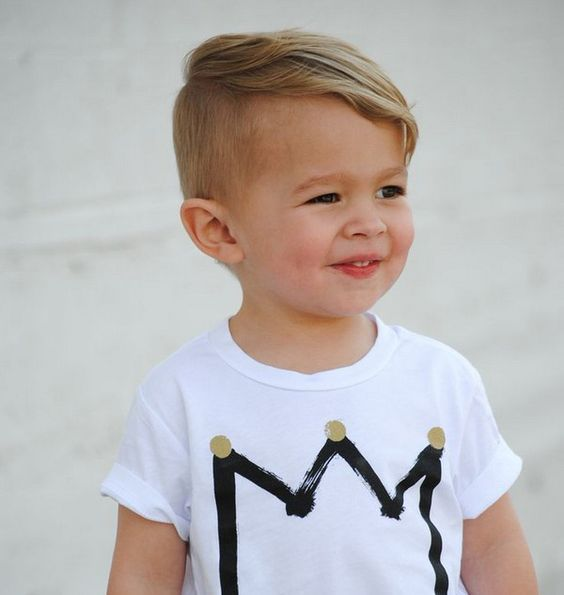 Cute boy haircut. Short on the sides and longer on top.