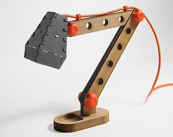 Trendy design due to wooden construction and colored power cable. Adam Bilsborough – Construction Lamp - inspired by Meccano.