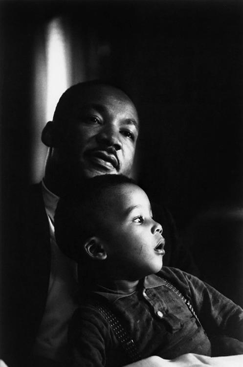 Dr Martin Luther King Jr with one of his children.