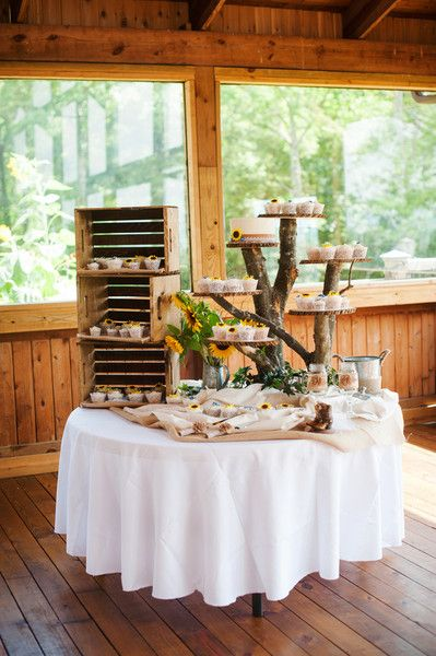 Rustic dessert display - tree cake stand and wooden boxes with assorted cupcakes and sunflowers {Skyryder Photography, LLC}