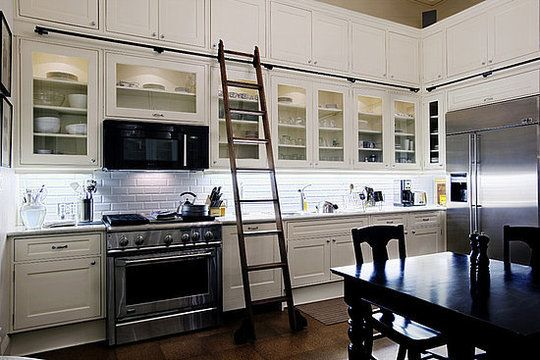 always loved library ladders after beauty and the beast - how perfect for the kitchen, and an all white kitchen at that!!