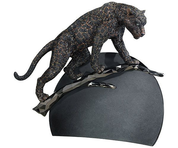 Simply breathtaking. This black jaguar is embellished with over 36'516 hand-set crystals and stands on a gun metal branch inspired by the animal's... Shop now