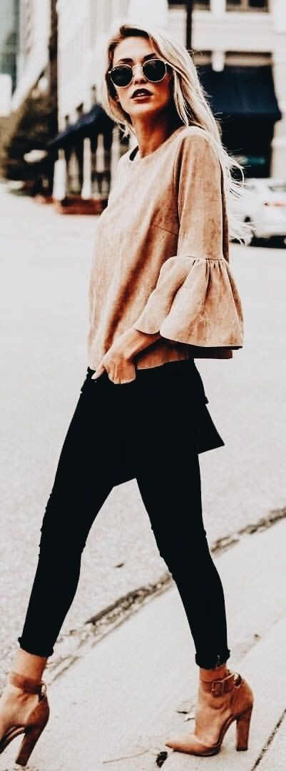 Pretty blush top with black skirt and leggings.