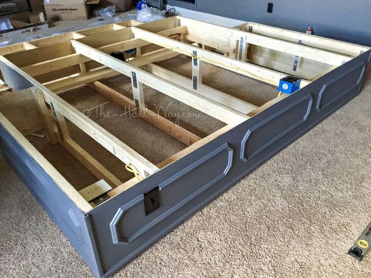 DIY Home Theater Platform- how to build.  wainscoting idea, outlet