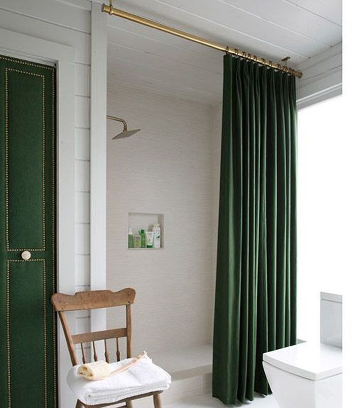 Hang a curtain from the ceilings to create the illusion of a larger shower. Give the rod a few coats of metallic paint adds a nice touch too.