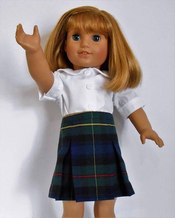 Navy blue plaid school uniform skirt with white blouse fits