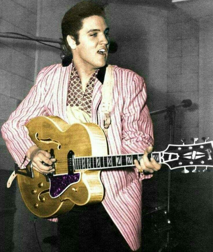Elvis in the studio playing on Scotty Moore's Gibson L5.