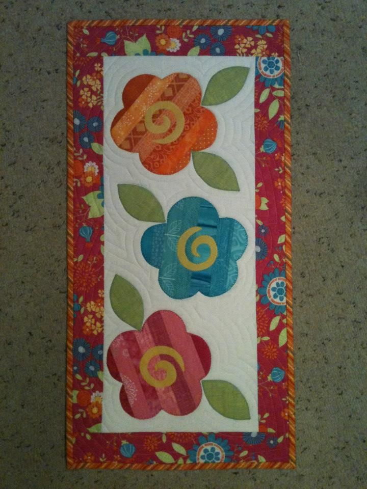 """Each quilt is appliqued and can be a wall quilt or table runner is approx. 14"""" x 28"""". This pattern has 3 great wall hangings."""