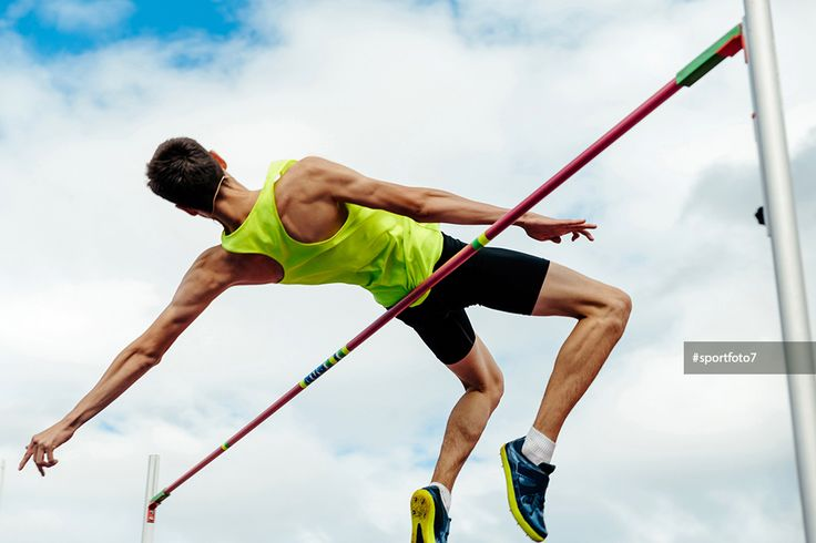 high jump male athlete successful attempt over bar