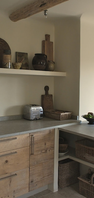 Wooden cabinets and stainless steel worktops in kitchen. I like the simple shelf too. Perfect