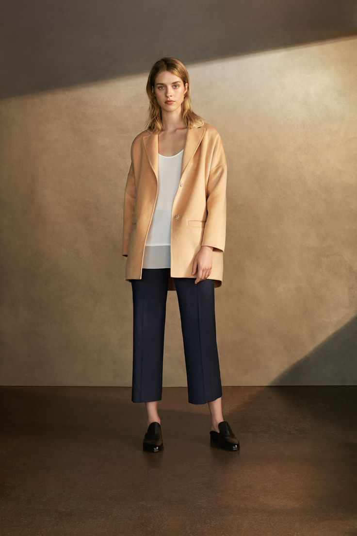 Golden sand coloured loose fitting blazer, paired with cropped black trousers and white top by Charli London.