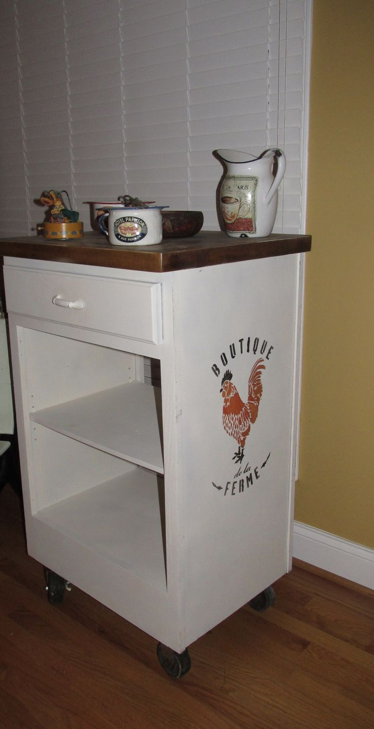"Recycled Kitchen Cabinet that was thrown to the curb. It is a Vintage Kitchen Island on Wheels w French Graphics. Drawer is ornamental only - faux drawer.   Measures 25 "" wide x 21 "" front to back and it is 41"" tall.   Reasonable offers are entertained."