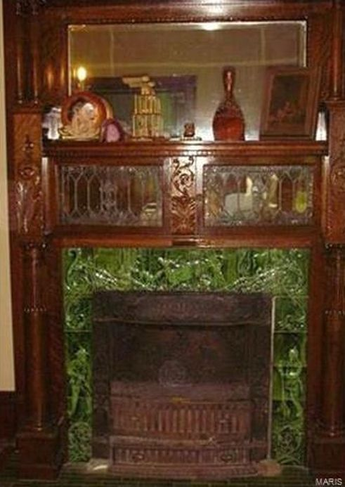 Historic Brick Home originally belonging to Otto Schmidt, built in 1908! Beautiful inlaid wood floors in the foyer with a grand staircase featuring brass dust catchers in each corner of every step. Several, stunning, stained glass windows and many original architectural features including 3 original ceramic front fireplaces, 7 bay windows, 2 guillotine windows, 3 upstairs balconies, 4 double & 2 single pocket doors, functioning decorative radiators, ornate wood trim, and an 8 x 7 Butler P...