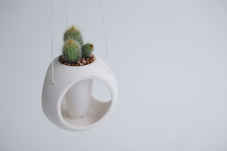 // Hanging porcelain planter by tokyocraftstudios