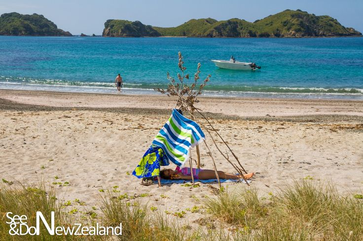 The Kiwi Tepee!  Instructions:   1. Find a gorgeous beach  2. Collect a few dead NZ native flax flowers or driftwood  3. Drape your towels over it   4. Relax in the shade and enjoy the view!