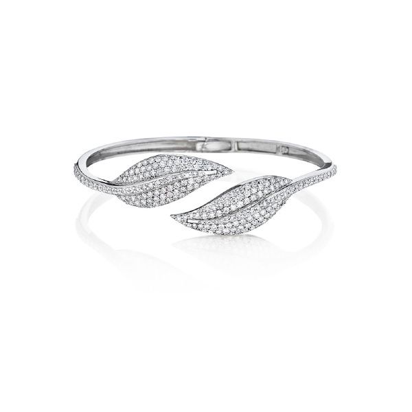 Leafs dipped in diamonds from the Elliptical Leaf Collection by Penny Preville. #Statement #wristcandy #leafjewelry #diamonds #PennyPreville #diamondbracelet #jewelry #walkinnature