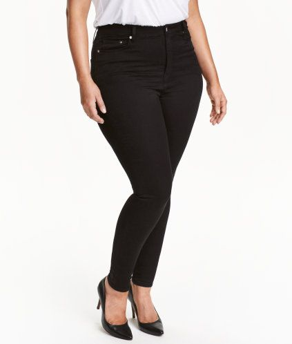 Svart. Ett par 5-ficksjeans i superstretchig, färgad denim. Jeansen har extra smala ben och hög midja.