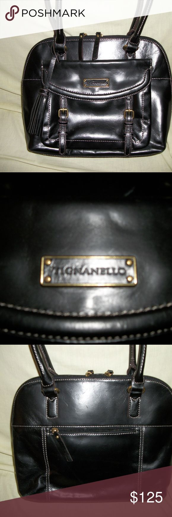 Tignanello Handbag 100% real leather, has 2 outside pockets (backside has zipper, front side has magnetic catch),  5 inside sections plus 2 pockets on one side and zipper compartment on other side (middle section has a zipper) and 4 stud feet on bottom.  I used this handbag one time. . .just like brand new!! This is a beautiful Tignanello handbag!  It also has RFID protection. Dimensions:  11 inches high                          14 inches wide                          4 inches deep (expends…