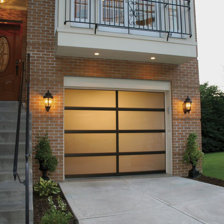 clopay avante collection aluminum garage door creates a glow on this fine home