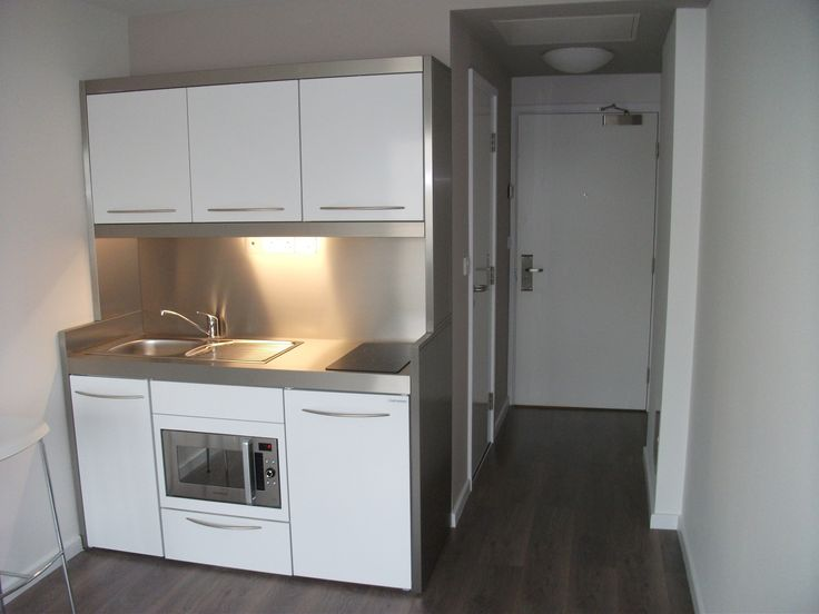 student accommodation, north london sink, and kitchen island/work  surface/storage facing the kitchenette, with eating bar extending within  the main living ...