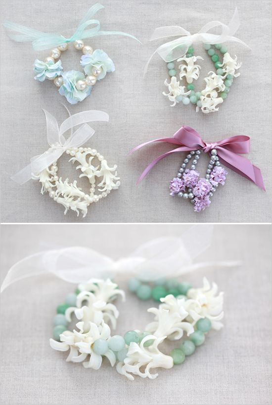 I really like the texture of this homemade jewellery because it links with my theme of flowers and it looks really original. I like the use of beads and ribbons used within the design of the bracelets.