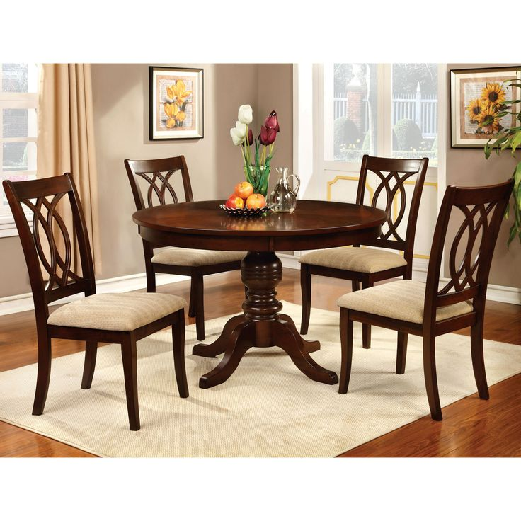 Classic and elegant, this round formal dining set provides a traditional touch to any dining environment. The sophisticated pedestal table pairs beautifully with the eye-catching chair back designs for a charming and inviting set.