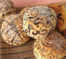 Painted bread rolls would be highly appropriate for a Lammas feast. These require parental help as they are painted half way through the baking process. The paint is a past made from cocoa powder or ground coffee.