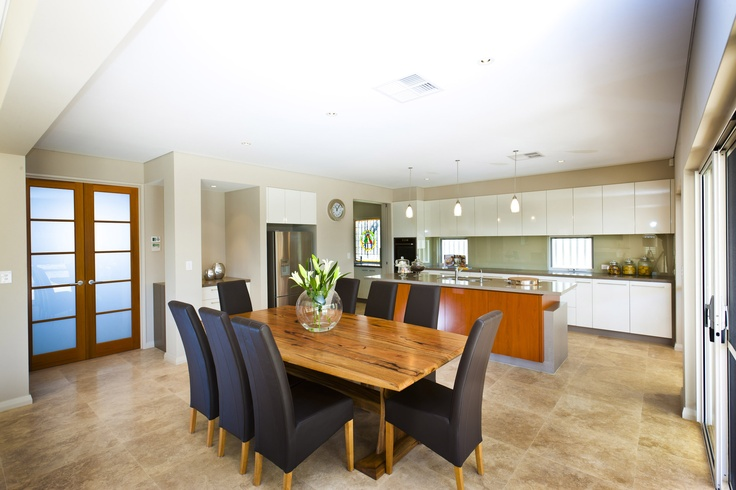 Beautiful honed travertine floor tiles in this lovely, warm kitchen/meals area.