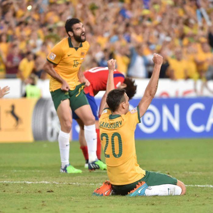 Sainsbury celebrates Asian Cup win - Australia's Trent Sainsbury (R) celebrates winning the Asian Cup final against South Korea in Sydney on January 31, 2015.