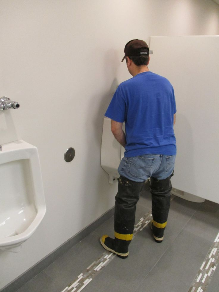 FIRE BOOTS AT THE URINAL Lets hope he doesnt