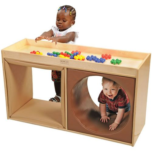 """Babies and toddlers will enjoy playing peek-a-boo as they crawl through each soft vinyl tunnel. The top of the wooden cabinet has a 1"""" lip to help waddlers learn to cruise around, and great for keeping toys from sliding off as they play. Children will build large muscle skills to help gain the confidence to go from crawling to making those first steps. 23""""H x 15""""W x 41 1/2""""L."""