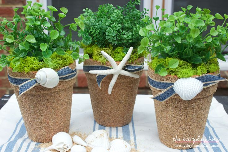 Using some Dollar Store pots and beach sand, you can easily and quickly create some Nautical-Inspired Sand Covered Pots to fill with plants or candles.