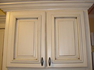 Sherwin Williams - antique white with a dark umber glaze paint kitchen cabinets